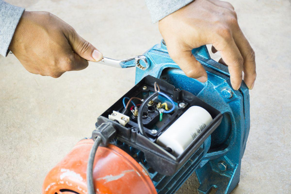 man fixing water pump